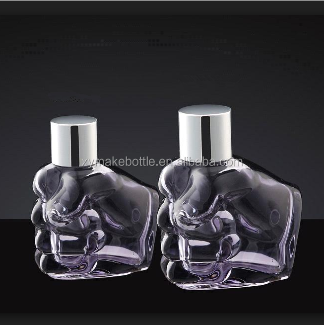 Fist shaped clear glass bottle with pump spray two different volume