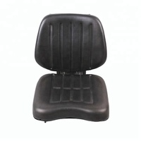 Adjustable tractor seat with shock absorber