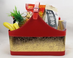 Gold and red color gift basket in faux leather
