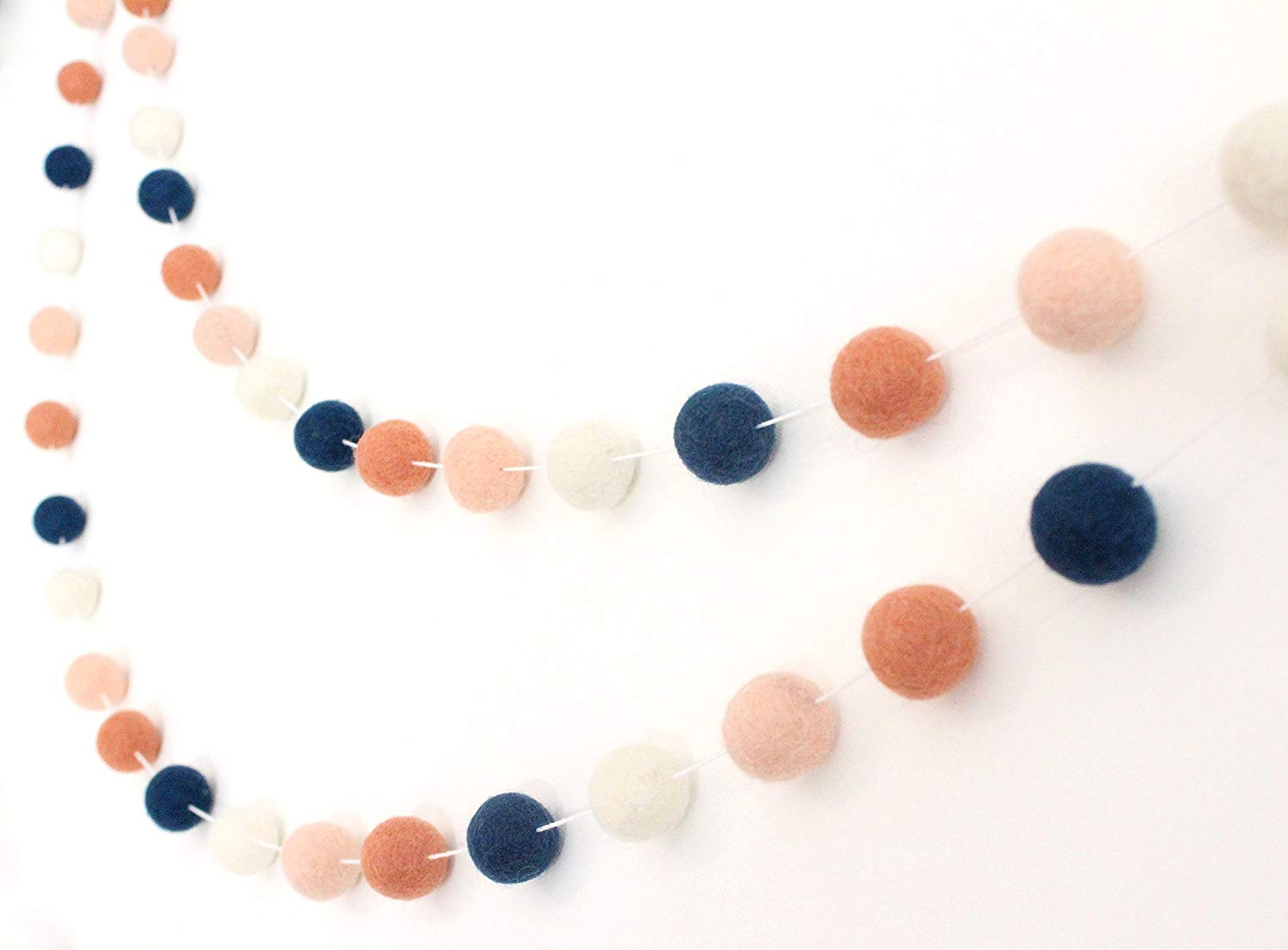 """Navy & Coral"" Handmade Wool Felt Ball Garland by Sheep Farm Felt- Apricot, Coral, Navy, and Ivory Pom Pom Garland. 2.5 cm balls."