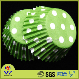 Green polka dots paper cup cake from birthday party supplier