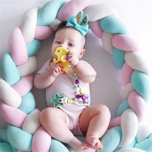 New Danish twist knot shape woven strip decoration pillow baby nursing crib protection fence pillow