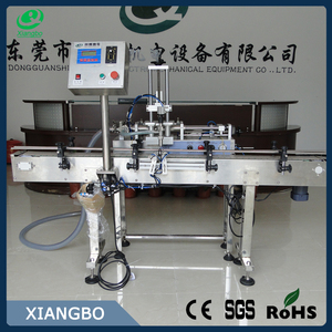 Low price automatic liquid filling machine with conveyor