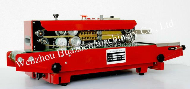 FRD900 horizonal irony shell red color plastic film continuous band sealing machine