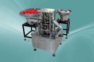 seal and cap assembly machine