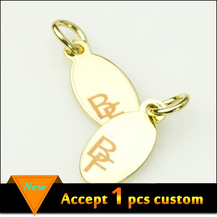 Fashion perhiasan grosir 11x6.5mm emas plating laser terukir logo kustom tag perhiasan logam