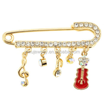 P168-603 gold fancy alloy clear rhinestone dangling musical note pins for dress and scarf