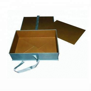Folding wrapping paper storage retail box with ribbon closures