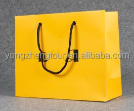 Paper shopping bag with yellow color with handle