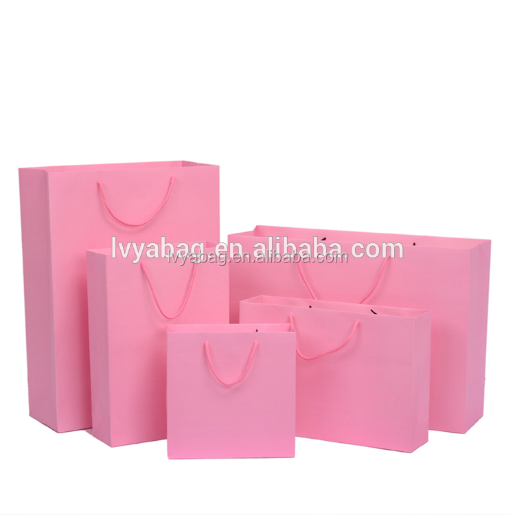 Fashion custom printed logo fancy shopping gift wholesale pink kraft paper bag with rope handle