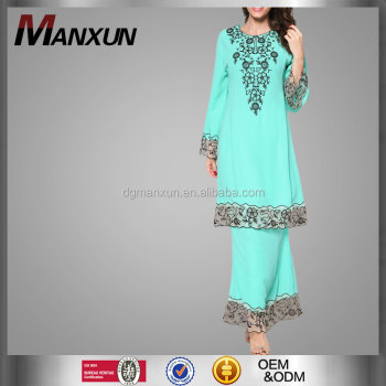 Blue embroldered fashion baju kurung with lace