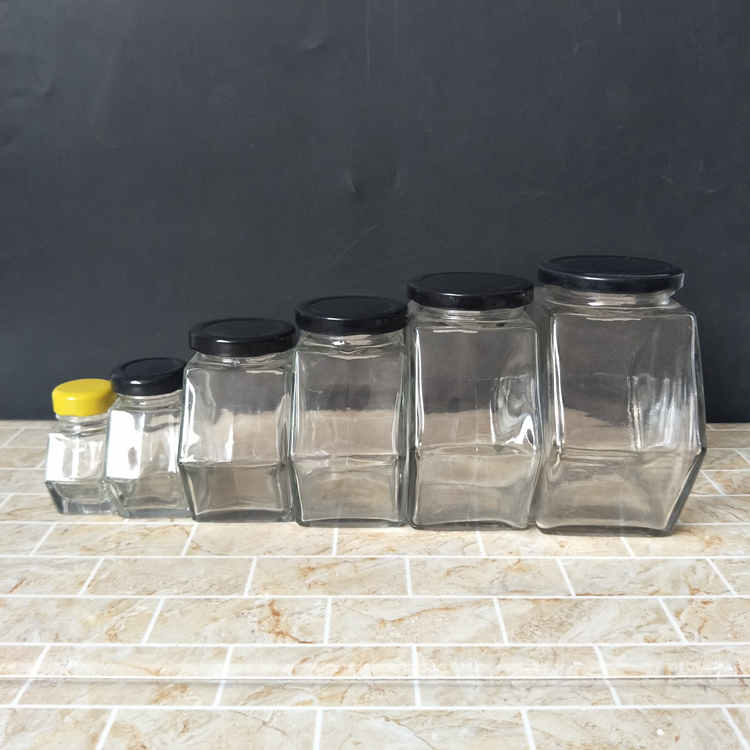 cheap small 30ml 100ml 300ml glass jars for honey with black lids