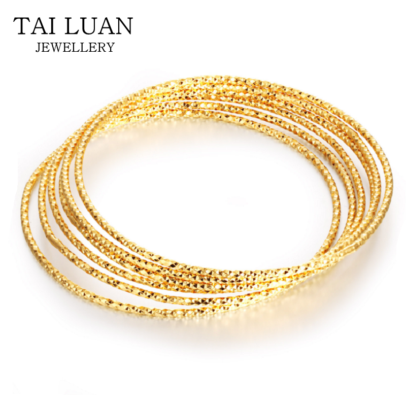 Delicate hand crafted thin bangle dubai gold bangles designs
