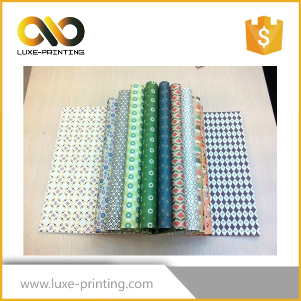 Custom design and logo factory OEM latest design festival gift packing wrapping paper red golden stamping gift bag