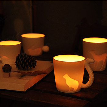 cheap white ceramic mug shape candleholder with intaglio printing new christmas lights candle cup for burner