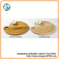 Wooden cheese board with carved pattern with ceramic cup