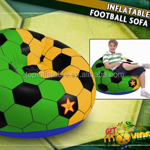 Colored outdoor relaxing inflatable football air chair in the garden