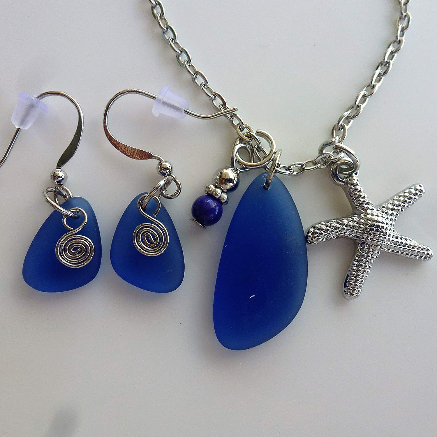 "SET of cobalt blue small 0.5 inch sea glass drop beach coast seashore EARRINGS and matching nautical recycled pendant on silver color starfish charm NECKLACE on 24"" inch chain with ocean mermaid tears"