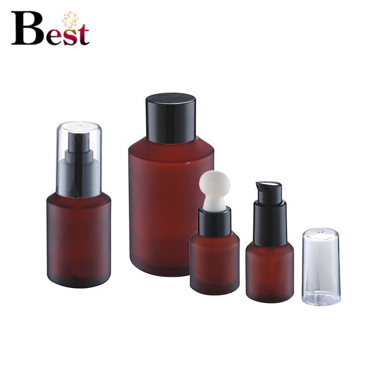 Cosmetic packaging painting 2oz frosted amber glass jars cosmetic glass bottle glass lotion bottle with black metal lid