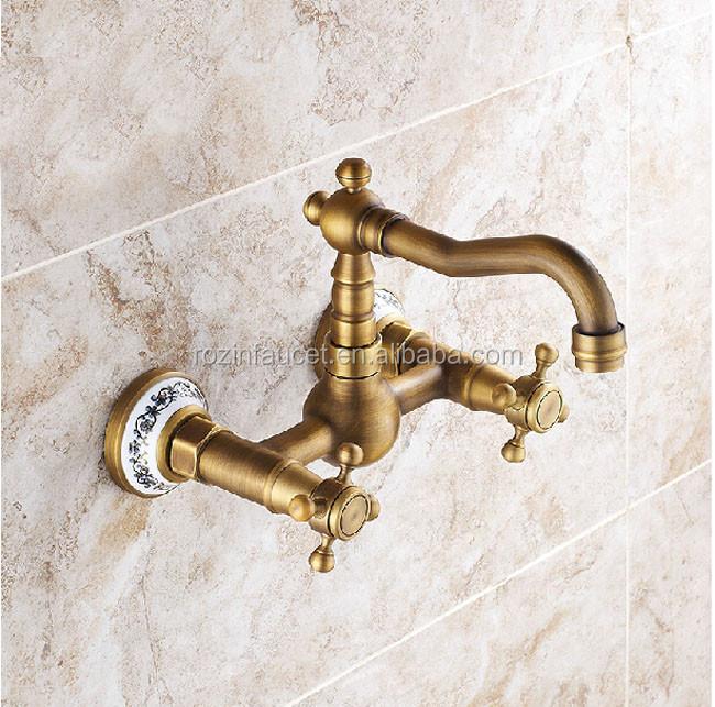 Montaje en pared doble maneja cocina agua caliente y fría grifo del ...