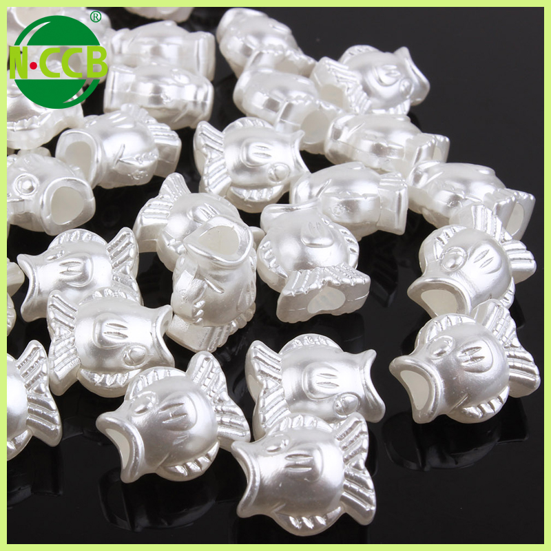 Half kg cheap pure white fish shape plastic pearl large hole beads