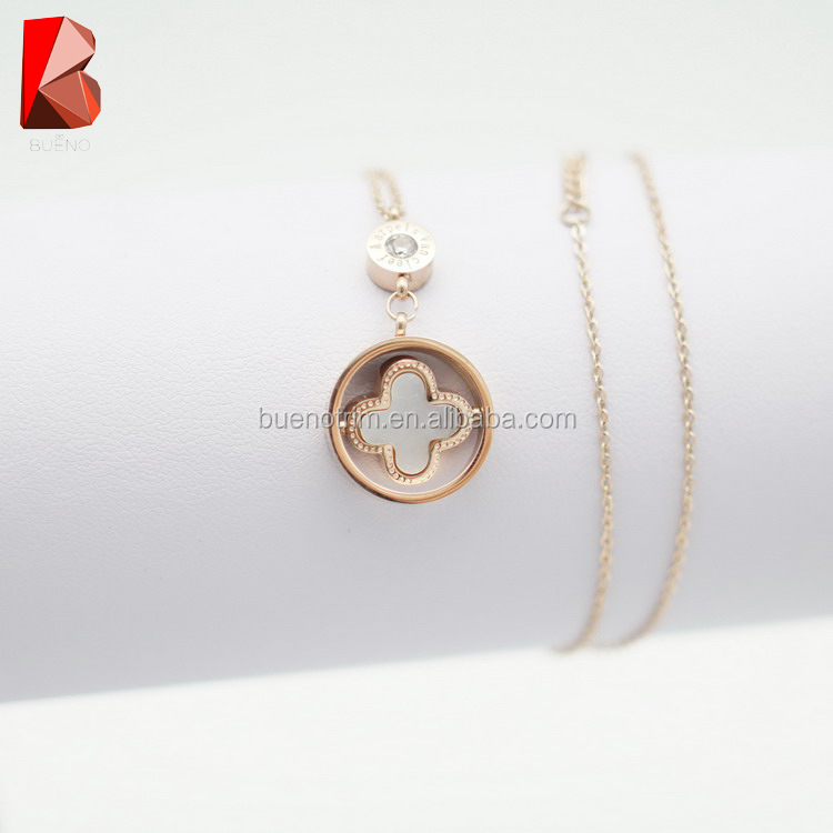 shiny gold stainless steel chain necklace with flower stone in the middle