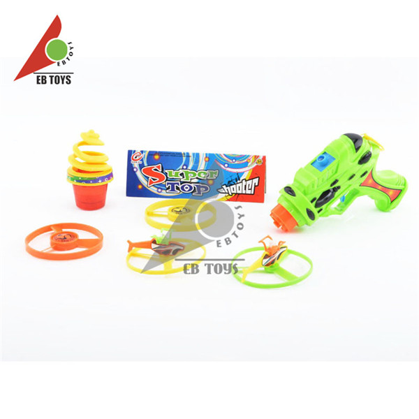 New arrival outdoor toy kid cheap mini flash ufo gyro plastic toy guns