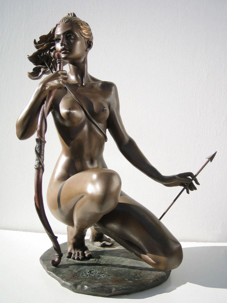 Bronze statue of a nude woman pouring water
