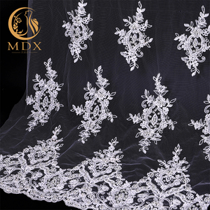 Hot selling custom made white textile tulle lace fabric for wedding dress