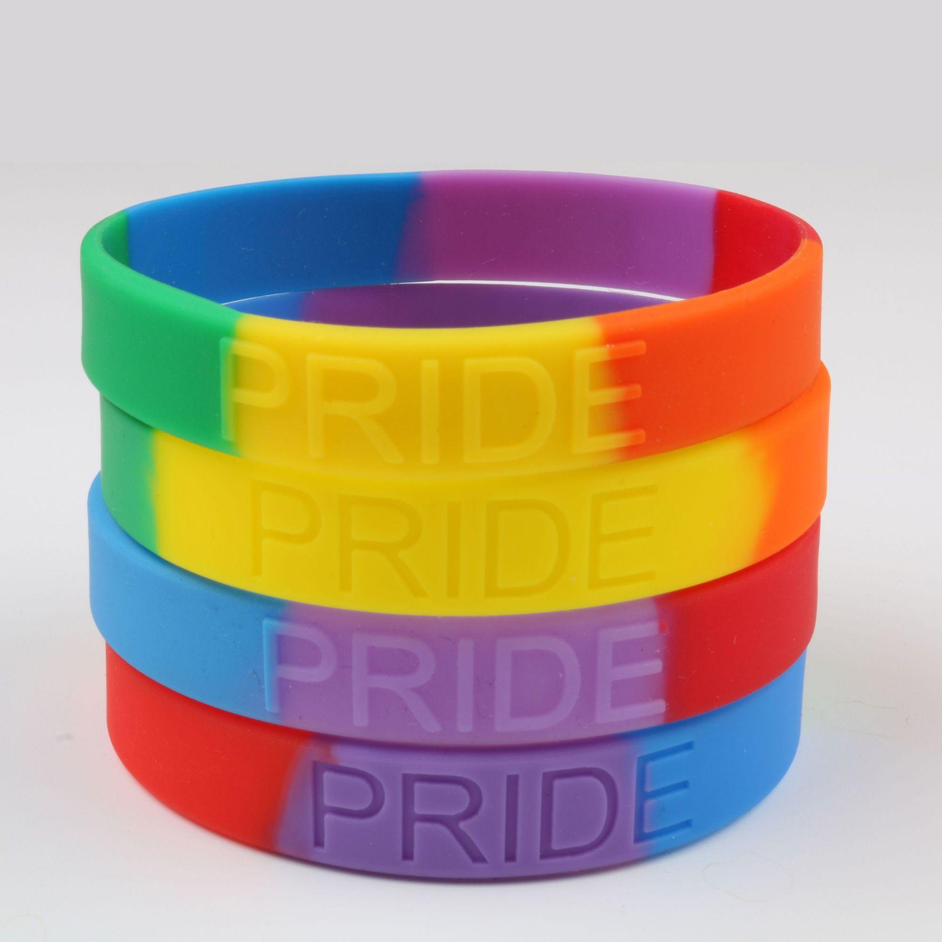 Hand Wearing Gay Pride Rainbow Wristband Stock Photo