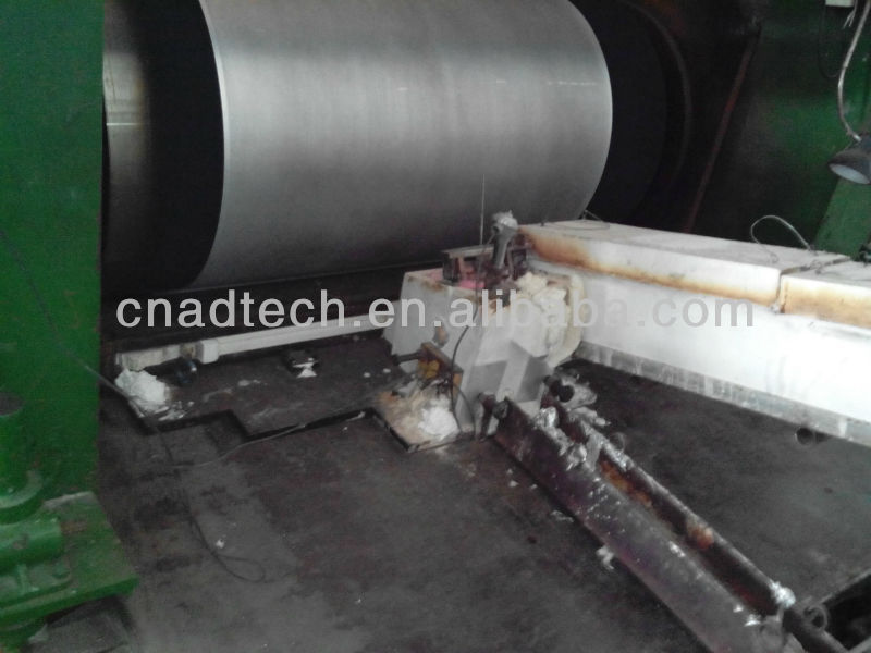 Nozzle refractory materials for continuous aluminum roll casting caster tip