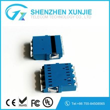 China Manufacturer FTTH Passive Plastic LC/PC Quad Optical Fiber Adapter Fiber Coupler with Fange for Fiber Telecommunication