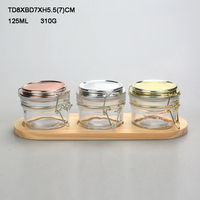 2 oz. glass jars with round airtight clip top lid