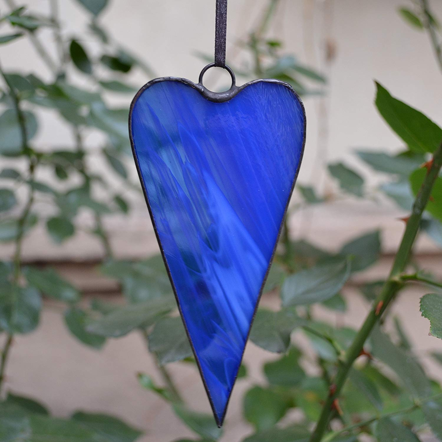 Whimsical tilda indigo blue heart ornament made of stained glass
