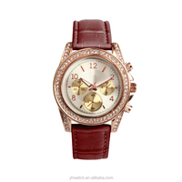 a rose gold color case with brown leather strap avon watches