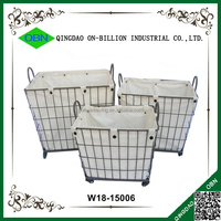 Large custom wheeled grey iron wire basket with fabric liner