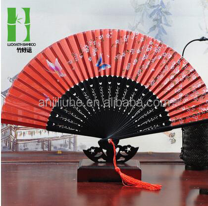 Traditional souvenir cloth folding fan with pouch