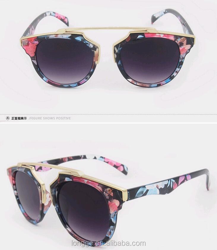 da9521758571a أزياء معدنية 2016 غلاف بلاستيكي نظارات القط العين النظارات الشمسية خمر  النساء الرجال النظارات الشمسية العلامة