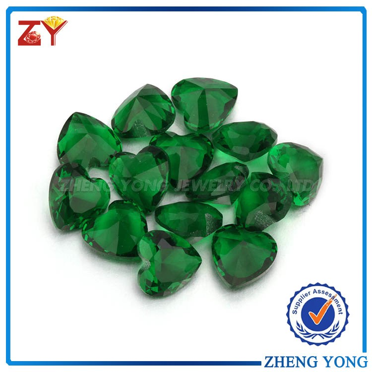 Loose synthetic heart machine cut emerald green glass gems