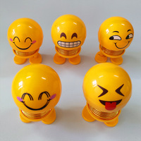 Smiley Emotion Plastic slinky toy, head swinging doll funny Car interior decoration