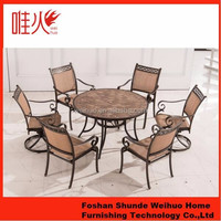 urban style cast aluminum round table and fabric chair