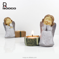 Roogo european fashion crafts polyresin christmas decoration angel candle holder