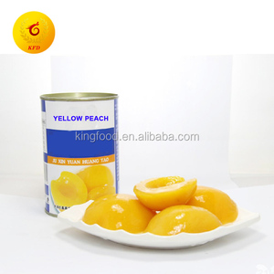 Delicious canned yellow peach in syrup in halves