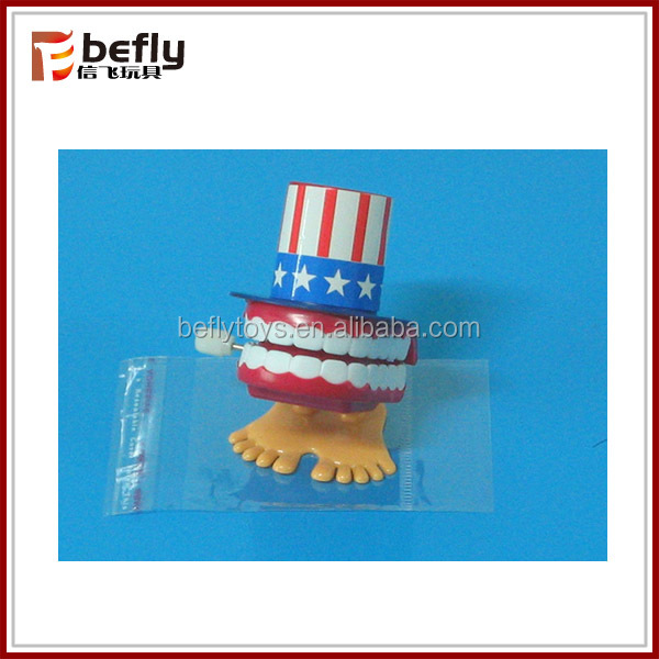 Funny toy jump teeth with hat