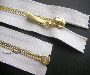 WHITE ZIP/ METAL GOLD TEETH OPEN ENDED.Different Sizes