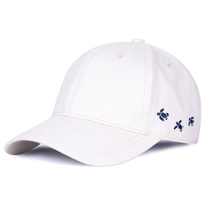 Hot selling bulk curved visor white baseball caps with cartoon embroidery logo