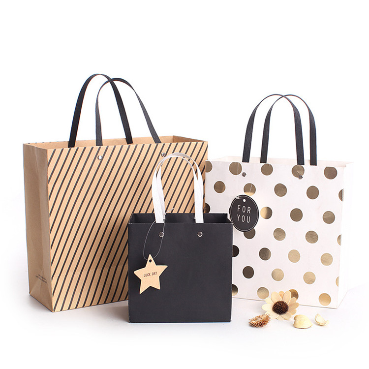 China Supplier Custom Logo Kraft Paper Bag Fancy Shopping Paper Bag for Dress Shirt Pants Printed Gift Bag for Cosmetics Product