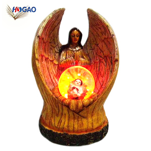 China import items wholesale resin home decor human religious led light snow globes