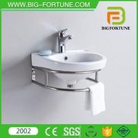 Washroom vanity towel hanging ceramic basin with stainless steel shelf