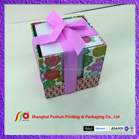 boxed colorful notepad with ribbon decoration